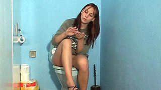 Ordinary looking brunette Nicole doesn't hesitate to suck a dick in toilet