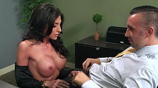 A busty woman that has black hair is getting fucked in the office